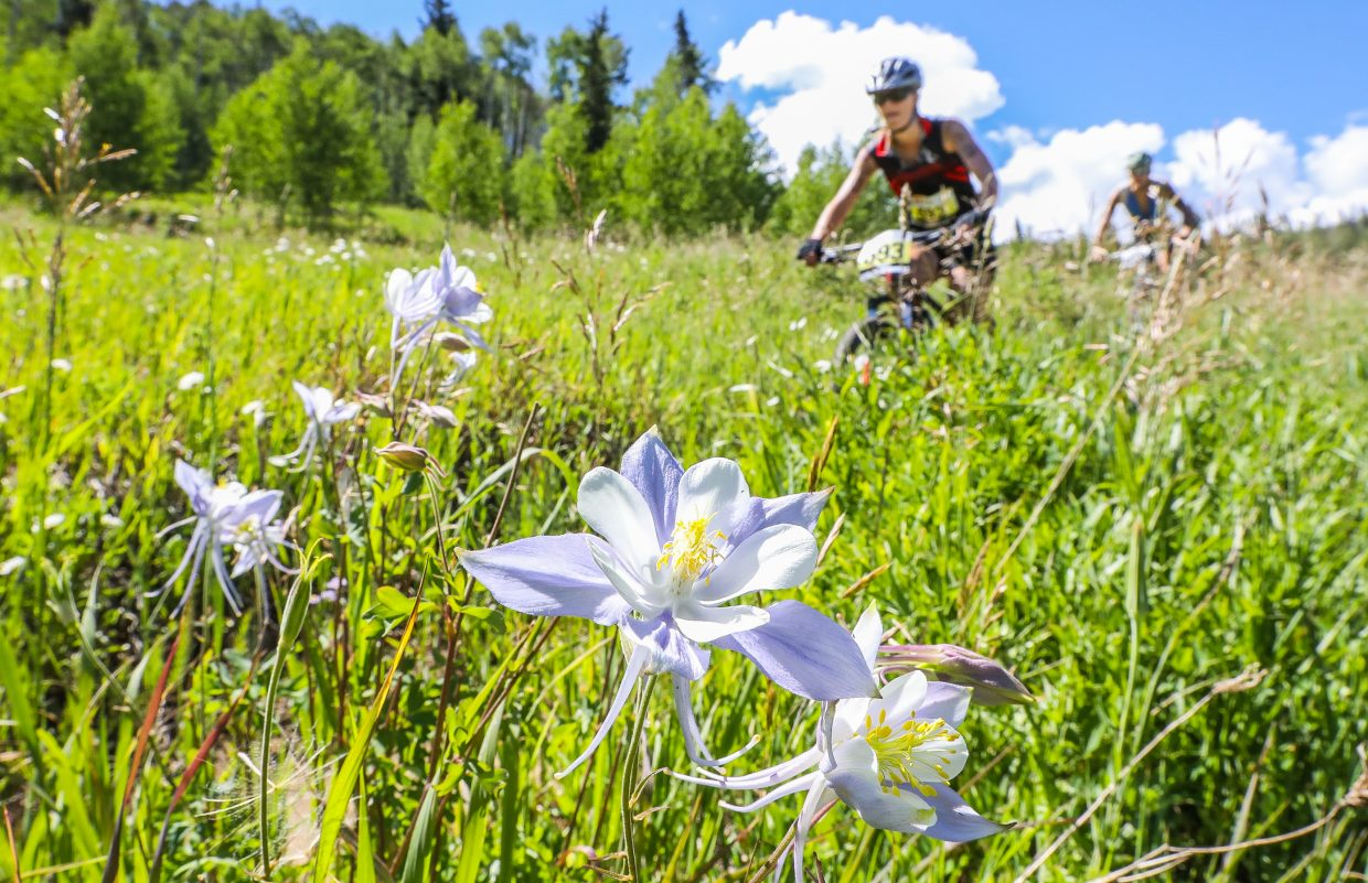Bikers make their way down Corkscrew Trail during the Xterra Beaver Creek race on Saturday in Beaver Creek. During the bike portion, racers climbed 3,600 in elevation gain.
