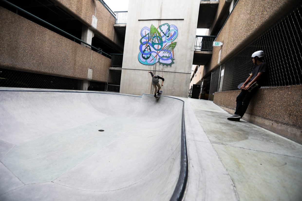 Rory Gallagher skates the bowl at the Lionshead skate park Monday, Aug. 7, 2017, in Vail, Colo. Gallagher was giving kids pointers and said it's a ton of fun to get out on the board for a little bit.