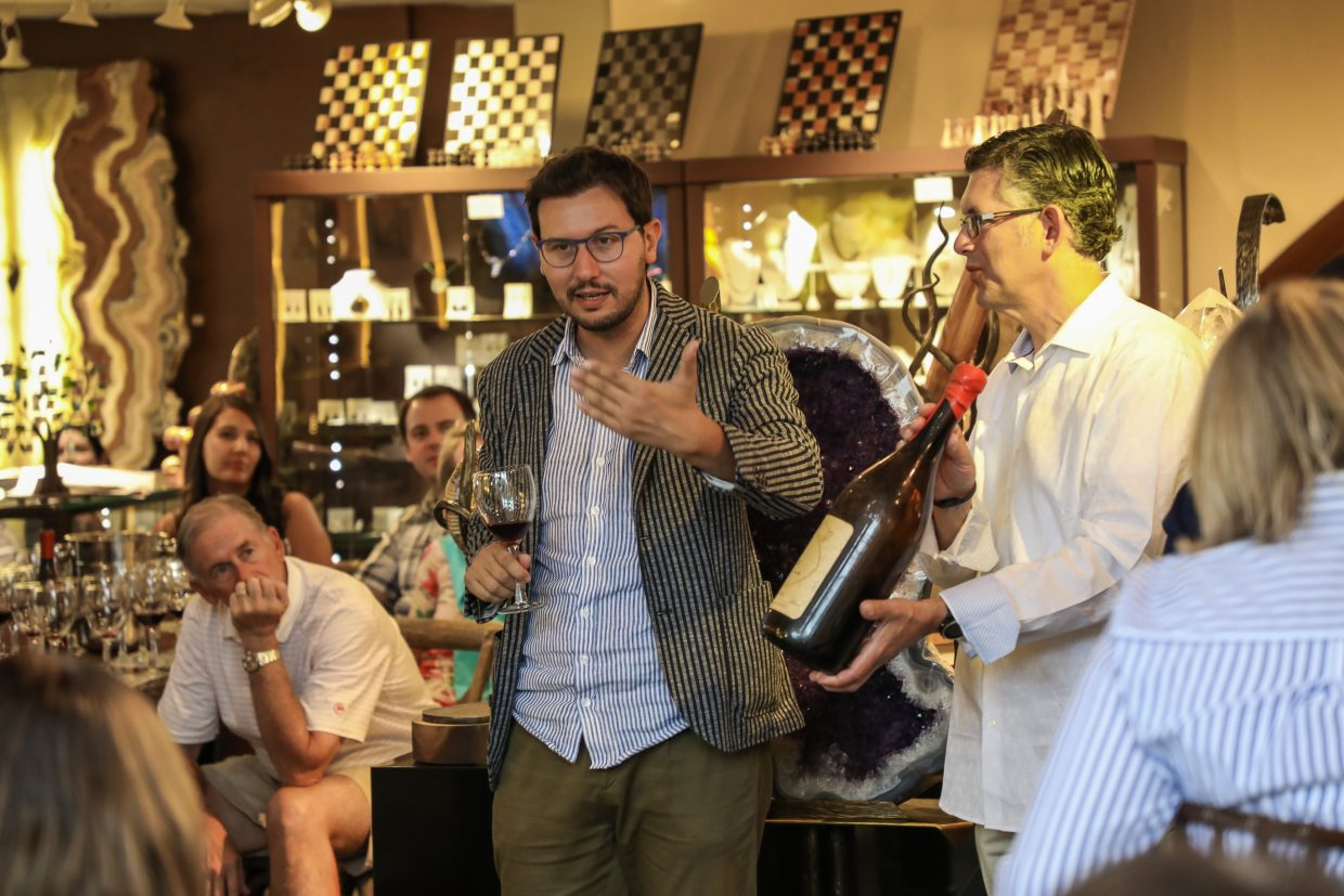 Claudio Viberti or Viberti Winery in Italy explains about his wines during the Best of Piedmont for Beaver Creek Wine and Spirits Festival Saturday, Aug. 12, 2017, at By Nature Gallery in Beaver Creek, Colo.
