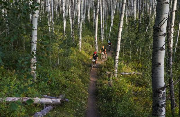 Riders make their way down Aspen Alley Trail during the Beaver Creek Blast on Wednesday in Beaver Creek. This was the last race of the season for the adults.