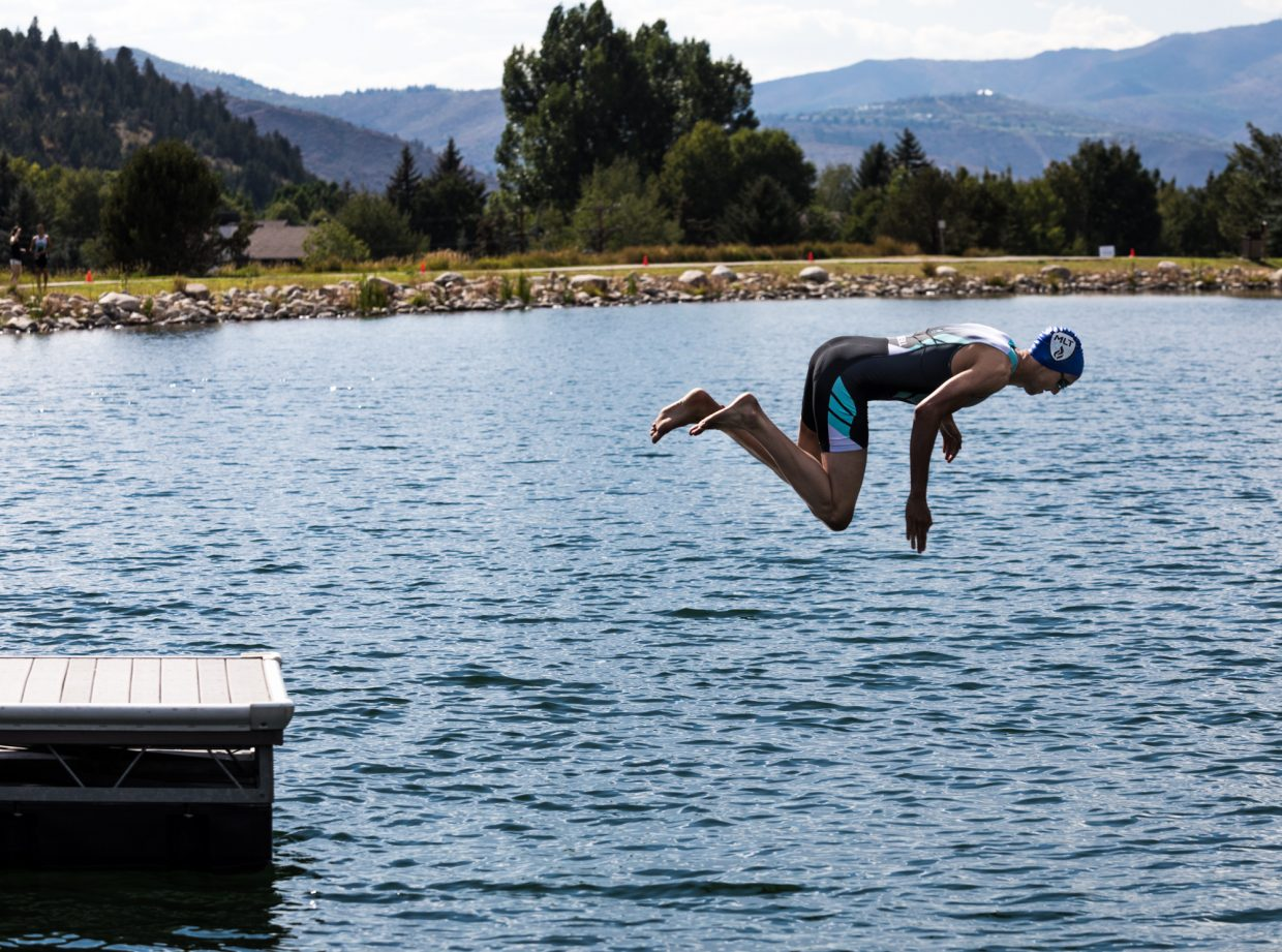 John O'Neill, of Edwards, spots his entry point into the water after diving into Nottingham Lake during the last team lap of the Major League Triathlon race Saturday in Avon. O'Neill helped his team the Colorado Peaks finish second in the race.