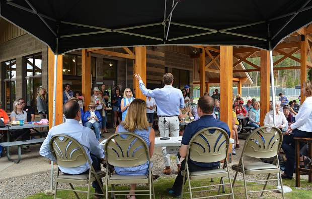 An enthusiastic throng of party faithful met four Democratic gubernatorial candidates in the 2018 election for a picnic at Breckenridge's Carter Park on Sunday afternoon, Aug. 20. Former state Sen. Mike Johnston speaks to the crowd as (from left to right) Denver businessman Noel Ginsburg, former State Treasurer Cary Kennedy and U.S. Rep. Jared Polis wait for their turn.