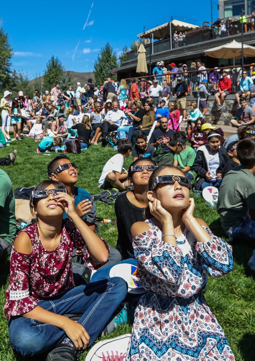 Kids from Avon Elementary School look at the eclipse through special glasses during the Walking Mountains Science Center's Eclipse Watch Party at the Westin Riverfront Resort and Spa Monday in Avon. Hundreds showed up to view the solar event, which hasn't happened it totality in the U.S. since 1979.