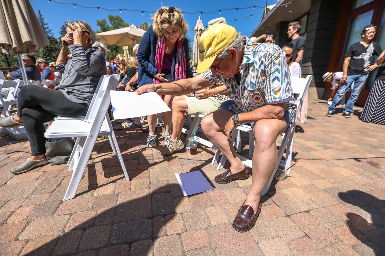 Lino Piedra of Eagle-Vail uses a pinhole projection to view the eclipse at the Walking Mountains Science Center's Eclipse Watch Party Monday at the Westin Riverfront Resort and Spa in Avon. People used special glasses and shadow techniques to view the eclipse.