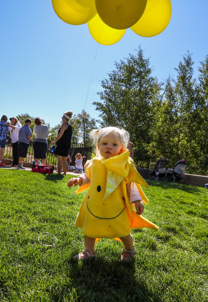 Riley Thompson, 1, wears a sun costume during the Walking Mountains Science Center Eclipse Viewing Party Monday at the Westin Riverfront Resort and Spa in Avon.