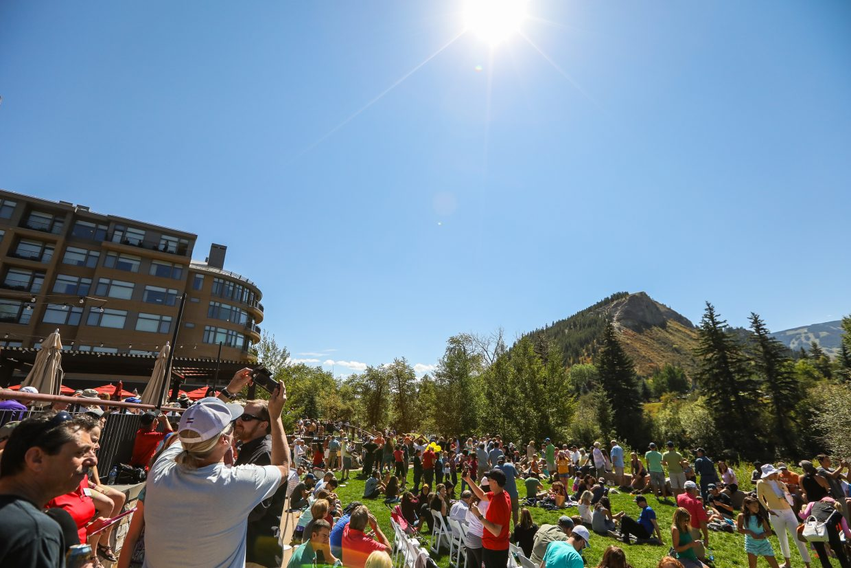 People watch the eclipse Monday, Aug. 21, at the Westin Riverfront Resort and Spa.