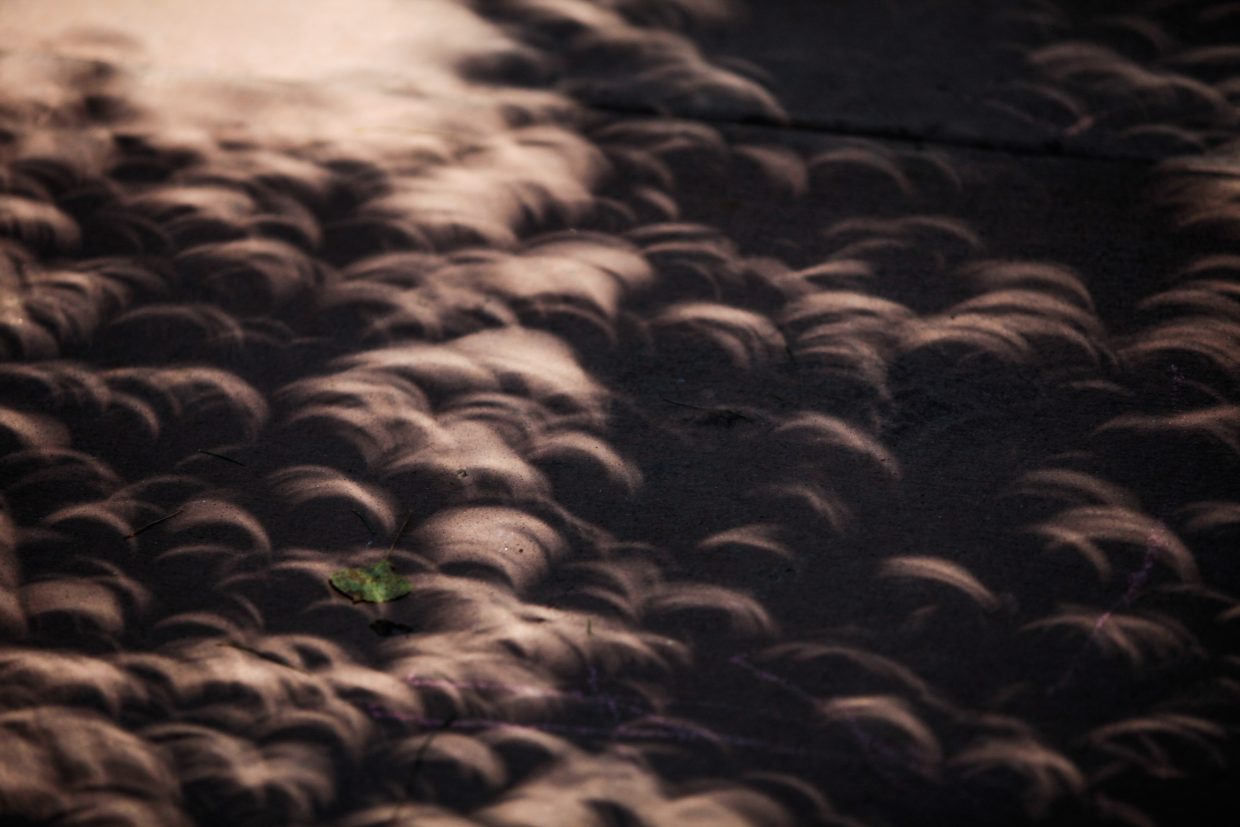Crescent shadows took over as the eclipse inched towards its peak of 91 percent Monday in Avon.