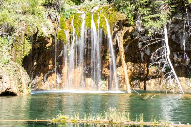 Hanging Lake is a popular tourist destination located in Glenwood Canyon, about 7 miles east of Glenwood Springs.