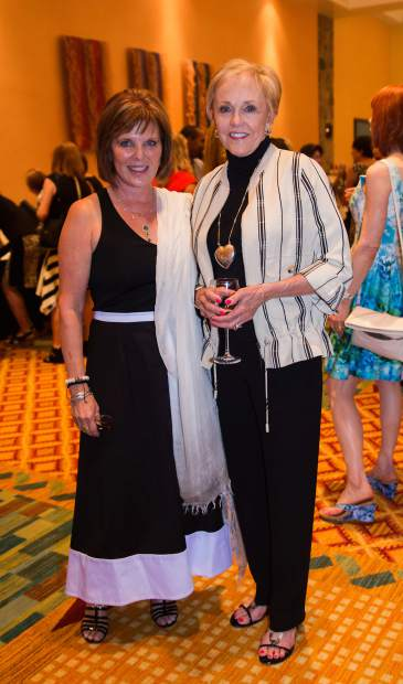 Debbie Courtney, who helped sponsor the event, celebrates with board member Linda Lund.