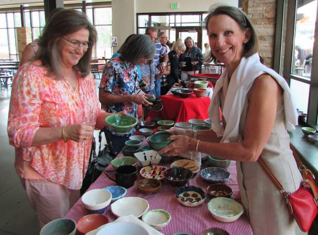 Netia Gerken helps Linda Moore pick out the perfect bowl. Each person at Empty Bowls leaves with an empty bowl — the international symbol for hunger.