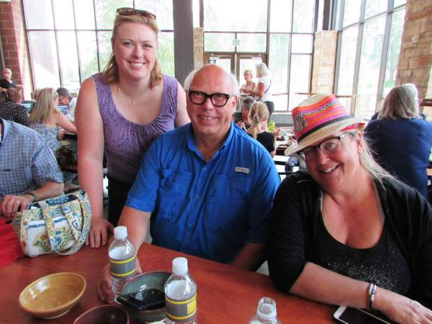 Tessa and Pelle Eklund with Colorado Mountain College's Willow Murphy enjoy the Empty Bowls event.