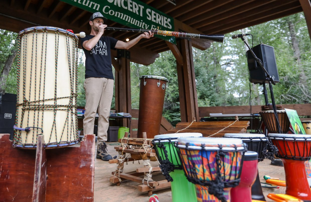 Brandon Draper plays the didgeridoo, native to Australia, during the Drum Safari performance for Education Foundation of Eagle County's School of Rock Camp Tuesday in Minturn. The annual camp takes place at Little Beach Park in Minturn, and the kids showcase their newly-acquired skills at a concert at the end of the five-day camp.