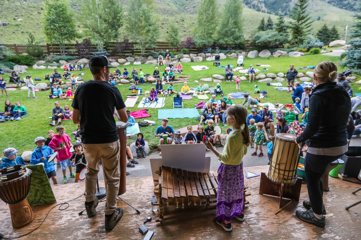 From left, Brandon, Eva and Teryn Draper of Drum Safari play some rhythms for the audience and School of Rock Campers Tuesday in Minturn. Drum Safari, of Kansas City, Mos., travel the country teaching about the value music has in a community.