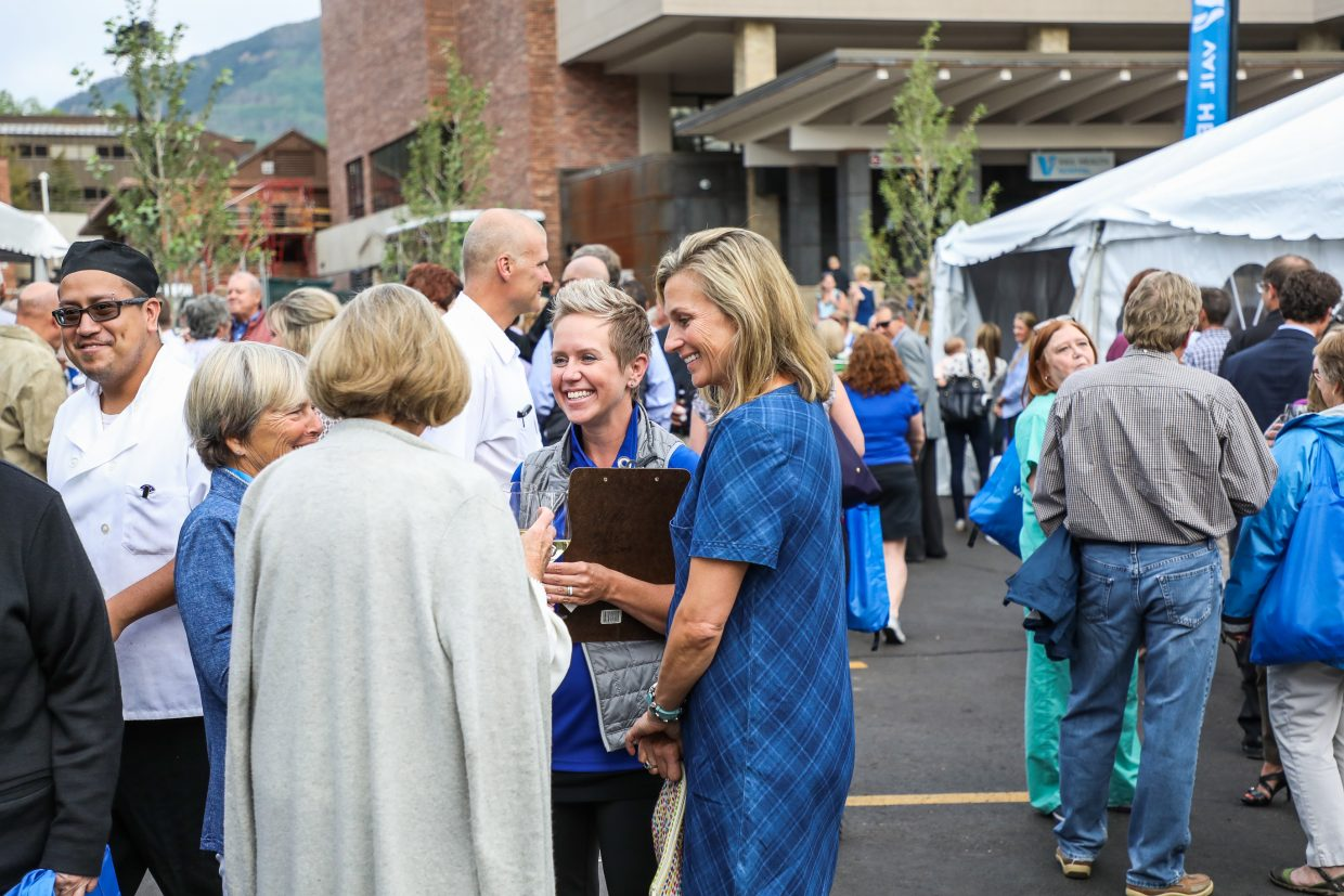 People mingle during the grand opening of the Vail Health Hospital Tuesday in Vail. The hospital will continue to undergo renovations.