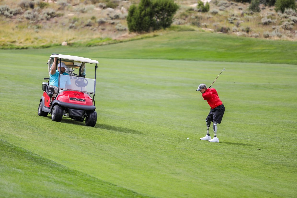 Tim Johannsen, Army, takes his second shot after hitting the fairway on the first hole of the Fazio Course at Red Sky Ranch and Golf Club for the Vail Veterans Progam Thursday at Red Sky Golf Club. The veterans played five days of course around the Vail Valley.