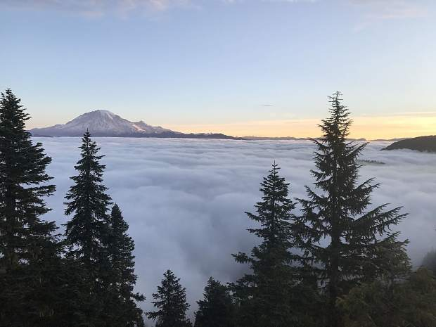 The view from Pompey Peak, above the clouds, along the Bigfoot 200 route.