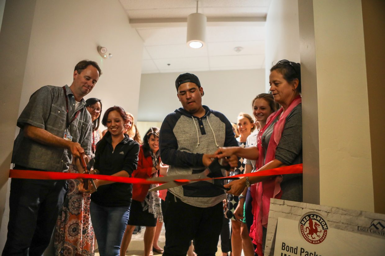 Staff and students cut the ribbon opening the new wing at Red Canyon High School's east campus Wednesday, Sept. 13, in Edwards. The addition will add classrooms and workspaces, as well as new lighting.