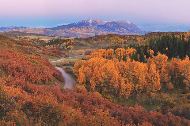 """""""Country Road,"""" by Kane Engelbert of Highlands Ranch, received a third place in the professional category in Colorado Mountain College's The Elevated Life photo contest. Second place in the professional category went to his brother, Charles Engelbert, for his photograph of Pyramid Peak and the Maroon Bells near Aspen."""