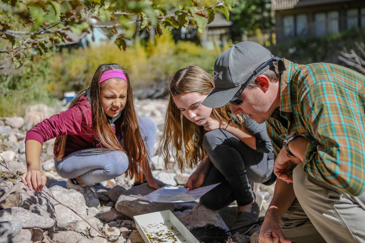 Pete Wadden, Watershed Education Coordinator with the Town of Vail, shows Citlalli Bernal, left, and Mackenzie Vroman of Gypsum Creek Middle School the living organisms in Gore Creek Thursday, Sept. 21, at Bighorn Park in East Vail. The Science, technology, engineering, and mathematics students (STEM) partnered with the Town of Vail to help restore the creek, while making it a part of their school curriculum.