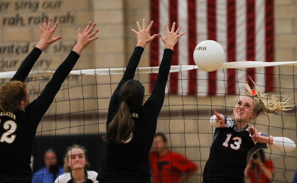 Becy Glutova of Eagle Valley spikes the ball against Battle Mountain Tuesday, Sept. 12, in Gypsum. The Devils won all three games.