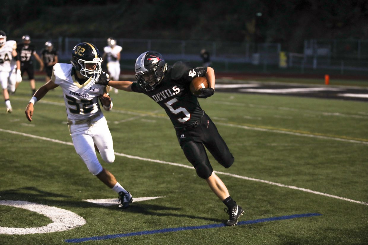 Eagle Valley's Nick Lauder runs the ball against Evergreen Friday, Sept. 22, in Gypsum. The Devils came in 0-3 on the season.