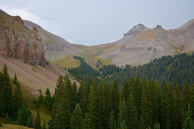 Looking from a hilltop towards the first pass in the Uncompahgre Wilderness. In this vast wilderness, there are numerous intersecting trail systems to choose from.