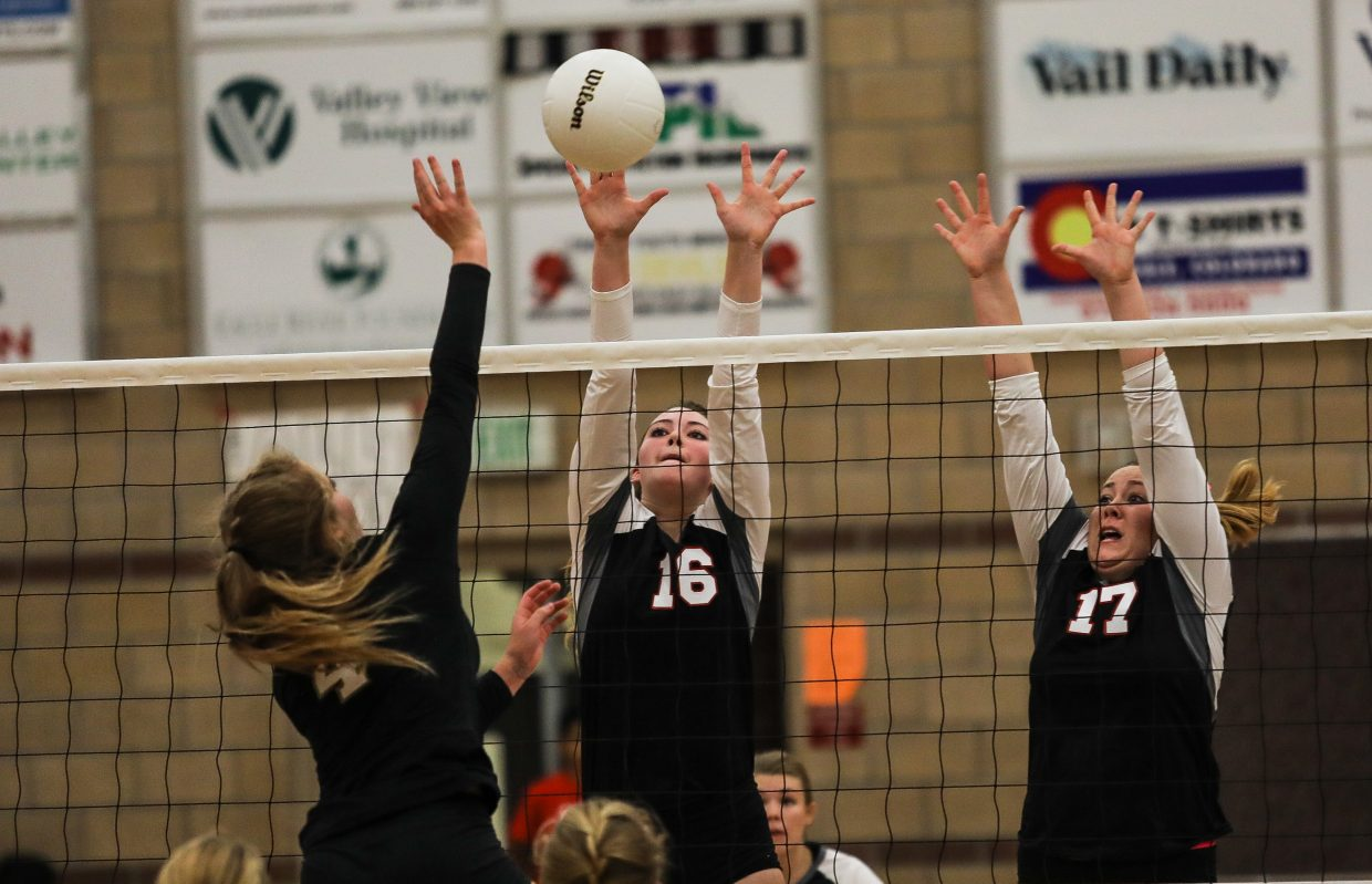 Bree Gates, left, and Rayne Lieurance of Eagle Valley block a ball against Battle Mountain Tuesday, Sept. 12, in Gypsum. The girls face Summit Thursday, Sept. 14, in Summit.