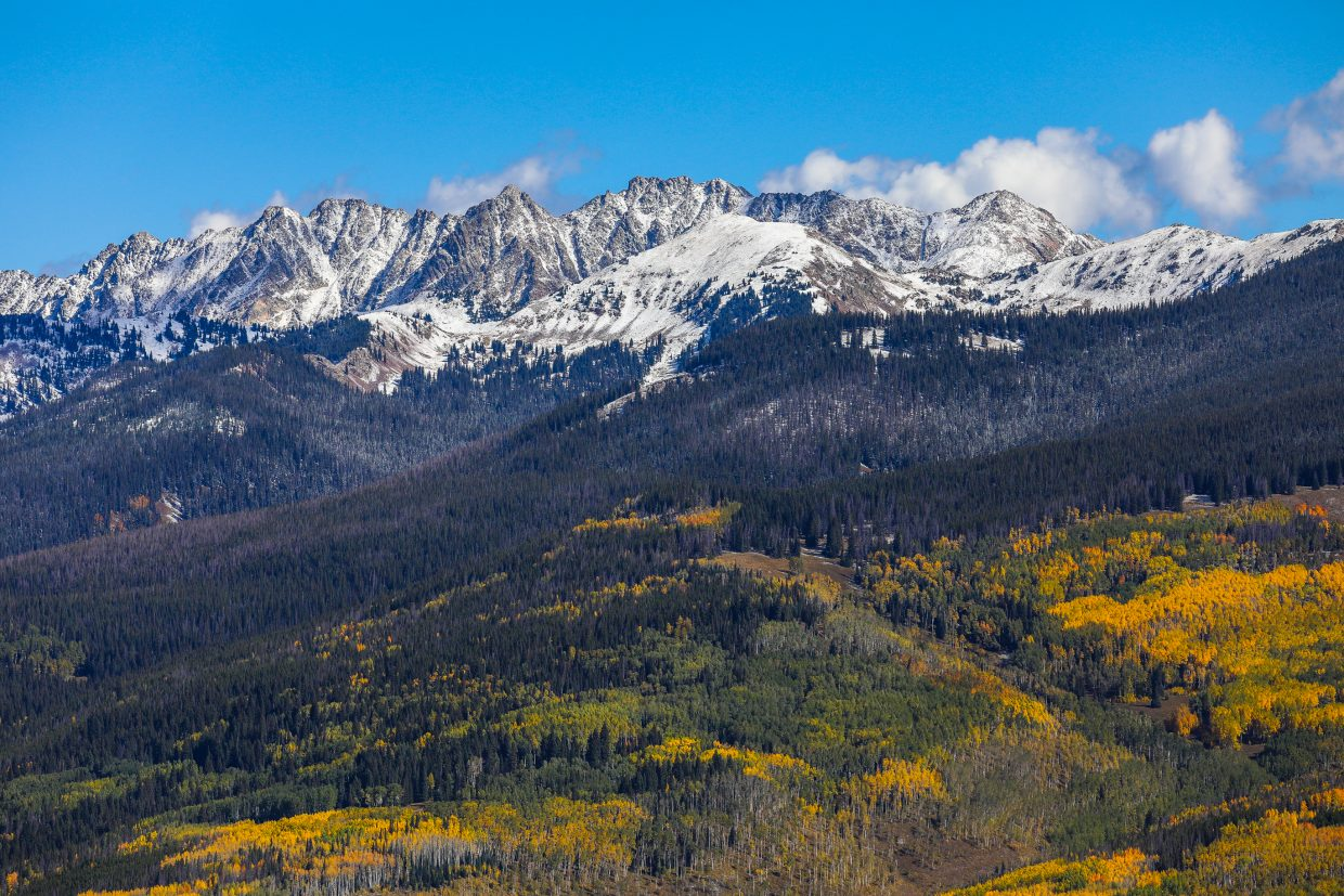 Snow-covered Gore Range and colors in Vail.
