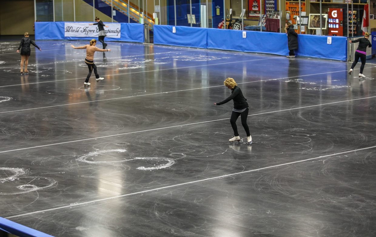 People compete during the World Figure Championships Saturday, Sept. 30, at Dobson Ice Arena in Vail. The figure has only been performed twice in competition.