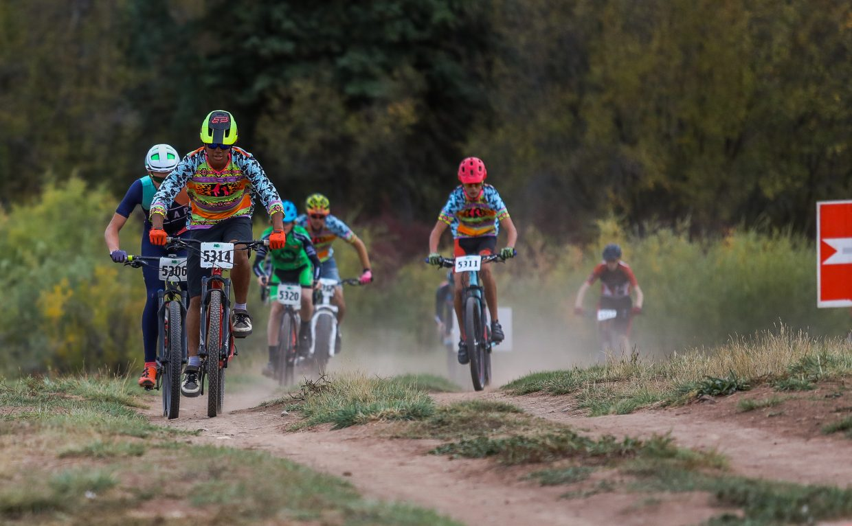 Racers fly down the course in the beginner cyclocross race Wednesay, Sept. 27, in Eagle.