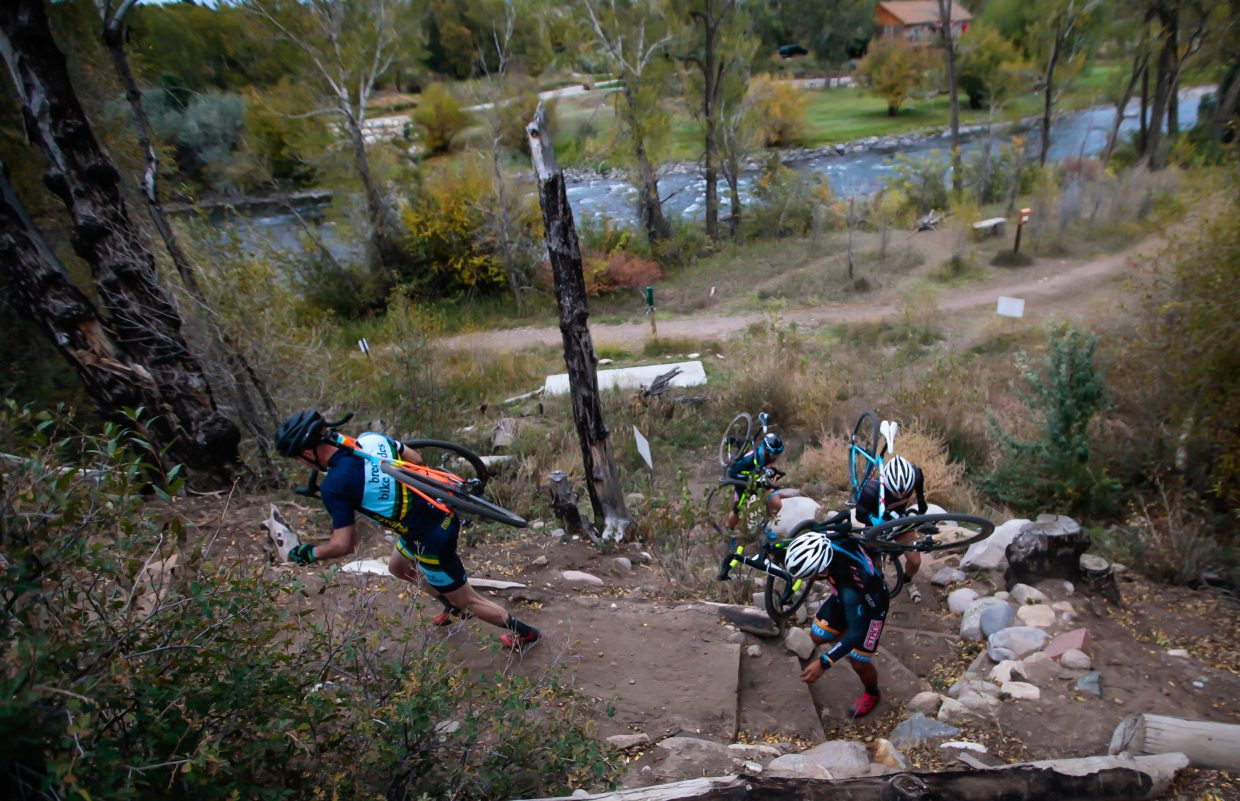 Racers climb the stairs section in the cyclocross race Wednesay, Sept. 27, in Eagle.