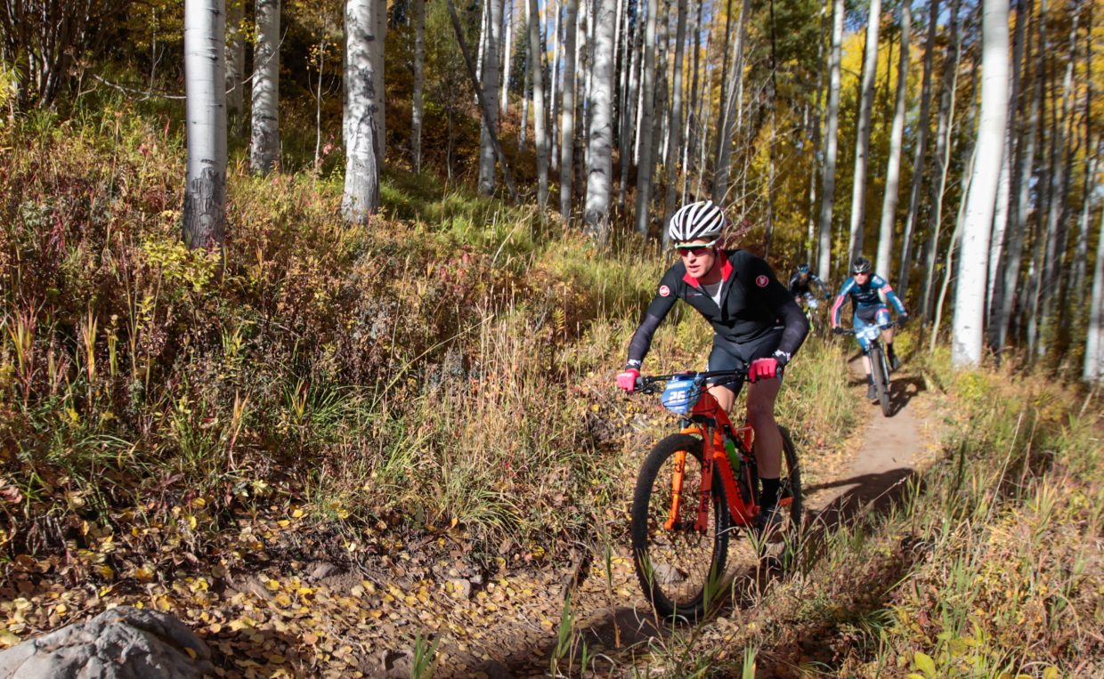 Riders make their way down Onza Alley during Scott Sparks XC for the Outlier Offroad Festival Saturday, Sept. 30, in Vail.