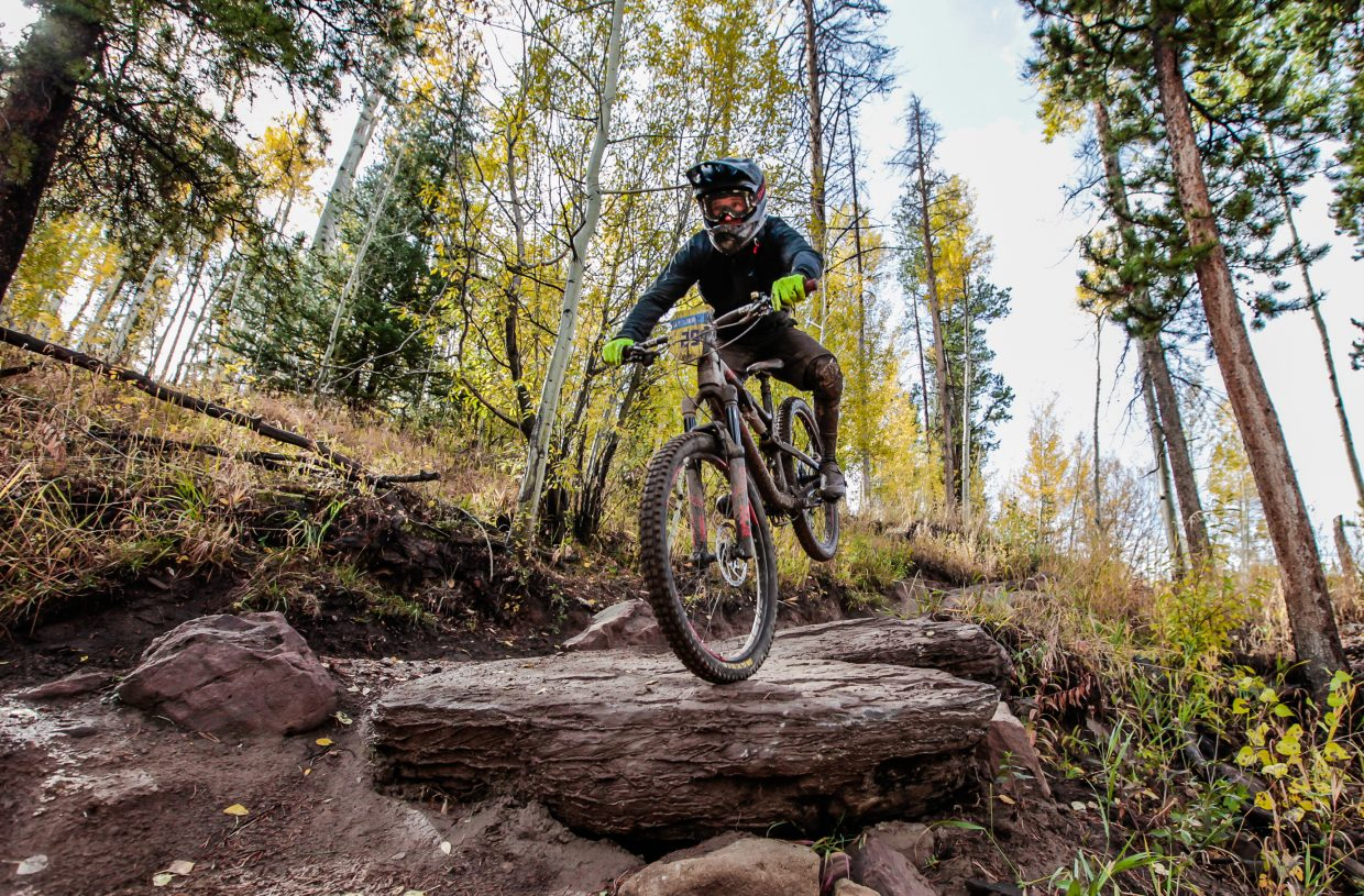 John Bailey launches on Mane Lane trail during the Rockshox Enduro race of the Outlier Offroad Festival Sunday, Oct .1 in Vail.