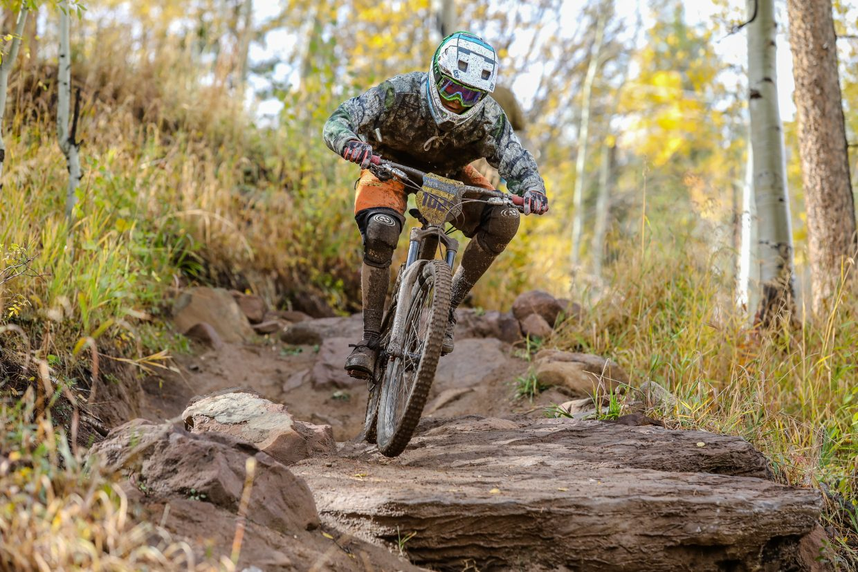 Eli Smith works the technical aspects of Mane Lane trail during the Rockshox Enduro race of the Outlier Offroad Festival Sunday, Oct .1 in Vail.