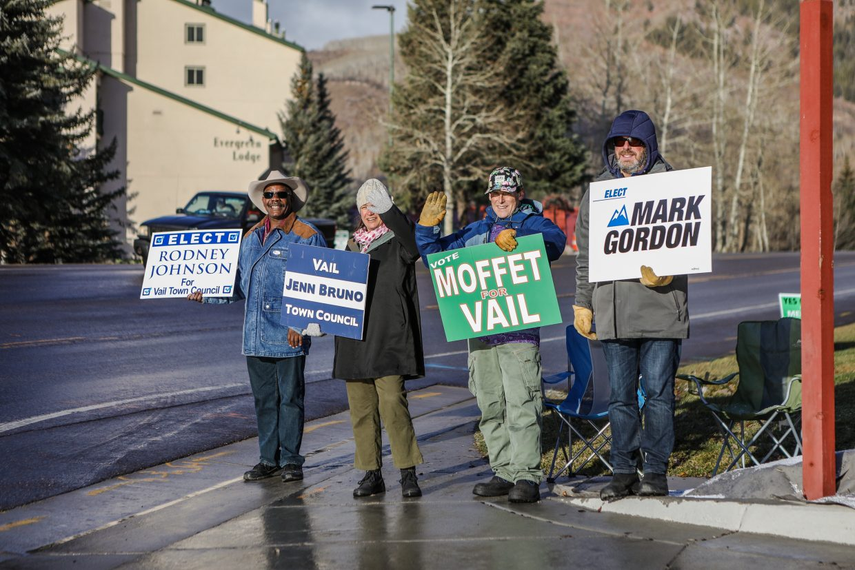 Vail Town Council candidates talk amongst themselves and waves to passing cars in front of town hall during election day Tuesday, Nov. 7, in Vail. Four seats are up for grabs on the council.