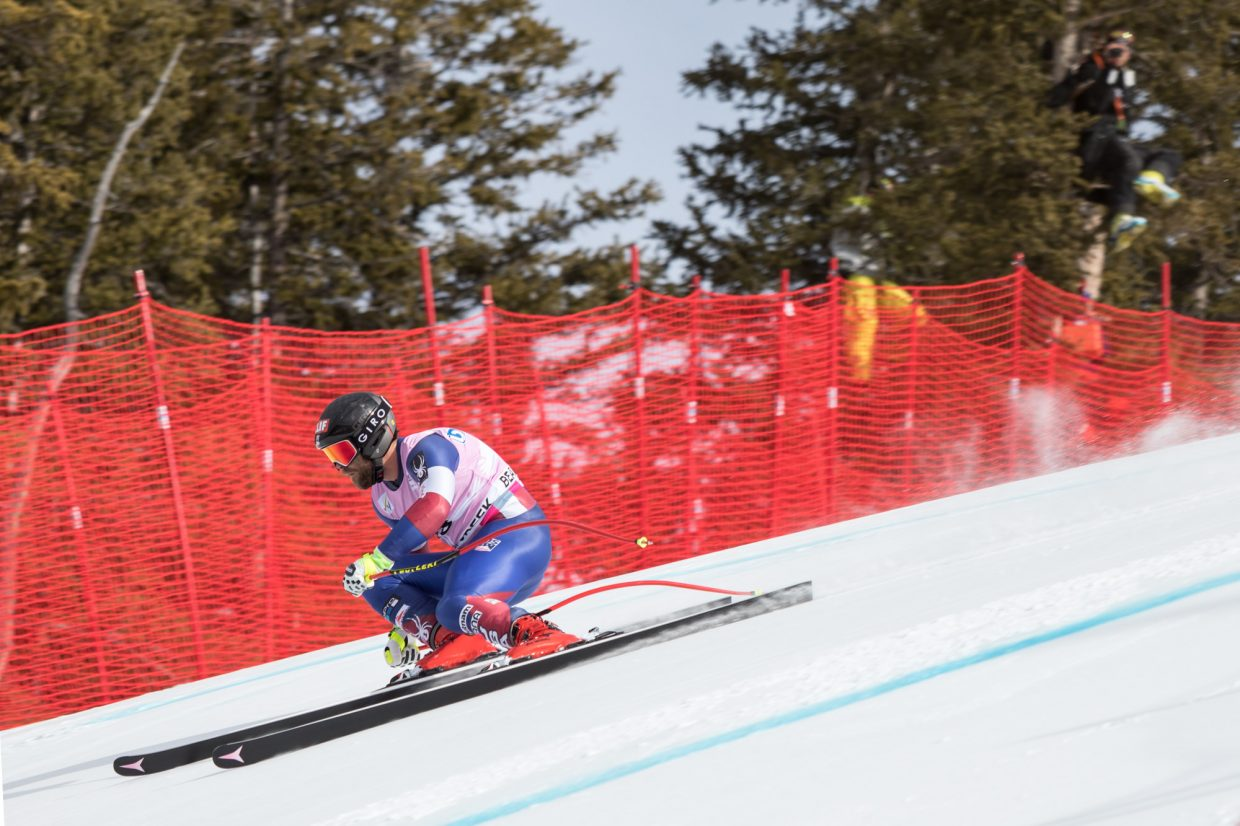 Travis Ganong, of the United States makes it over the first roll into the Brink section during the first day of training for the World Cup ski race Wednesday in Beaver Creek.