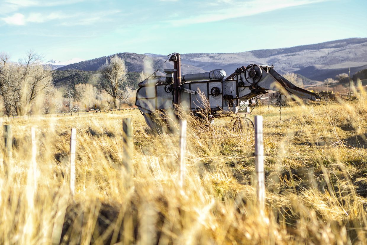 An old piece of farm equipment hangs out in a field off Brush Creek Road Friday, Nov. 3, in Eagle. Snow is forcasted through the weekend and could leave the upper elevations with more than a foot of snow by Tuesday.