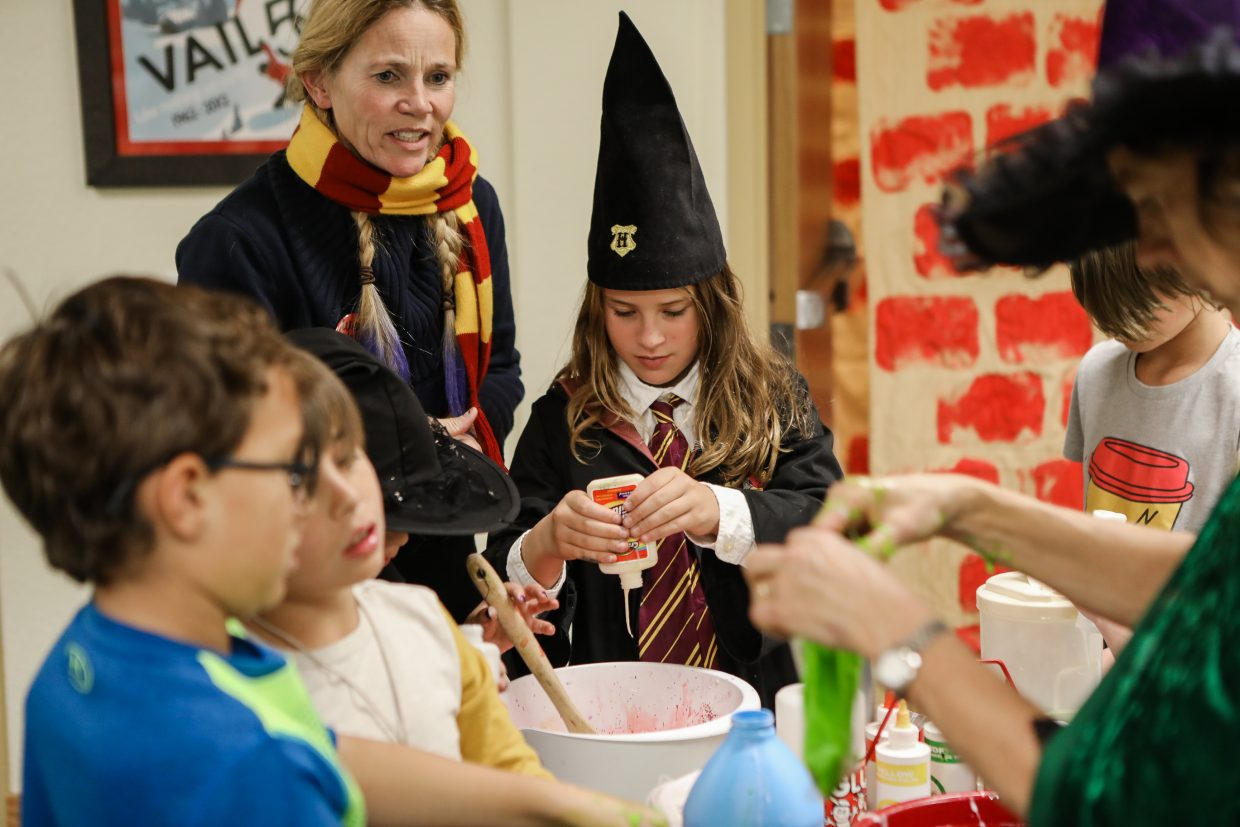 Alessia Basso of Eagle mixes ingredients for slime during the Vail Public Library Harry Potter Party Saturday, Nov. 4, in Vail. Different crafts stations were available to make Harry Potter-related crafts.