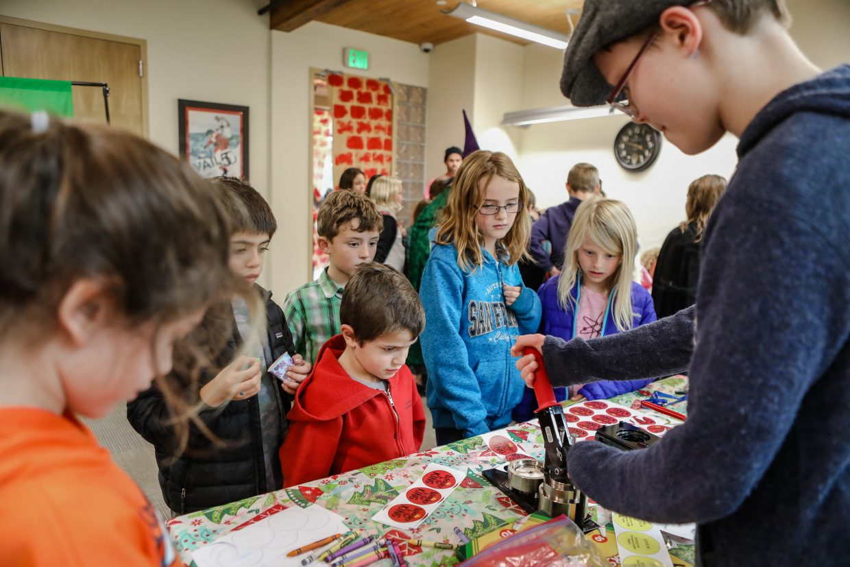 Joaquin Cortina (front red sweatshrit) waits for his Harry Potter button during the Harry Potter Party through the Vail Public Library Saturday, Nov. 4, in Vail. The party was to help celebrate Harry Potter's 20th anniversary.