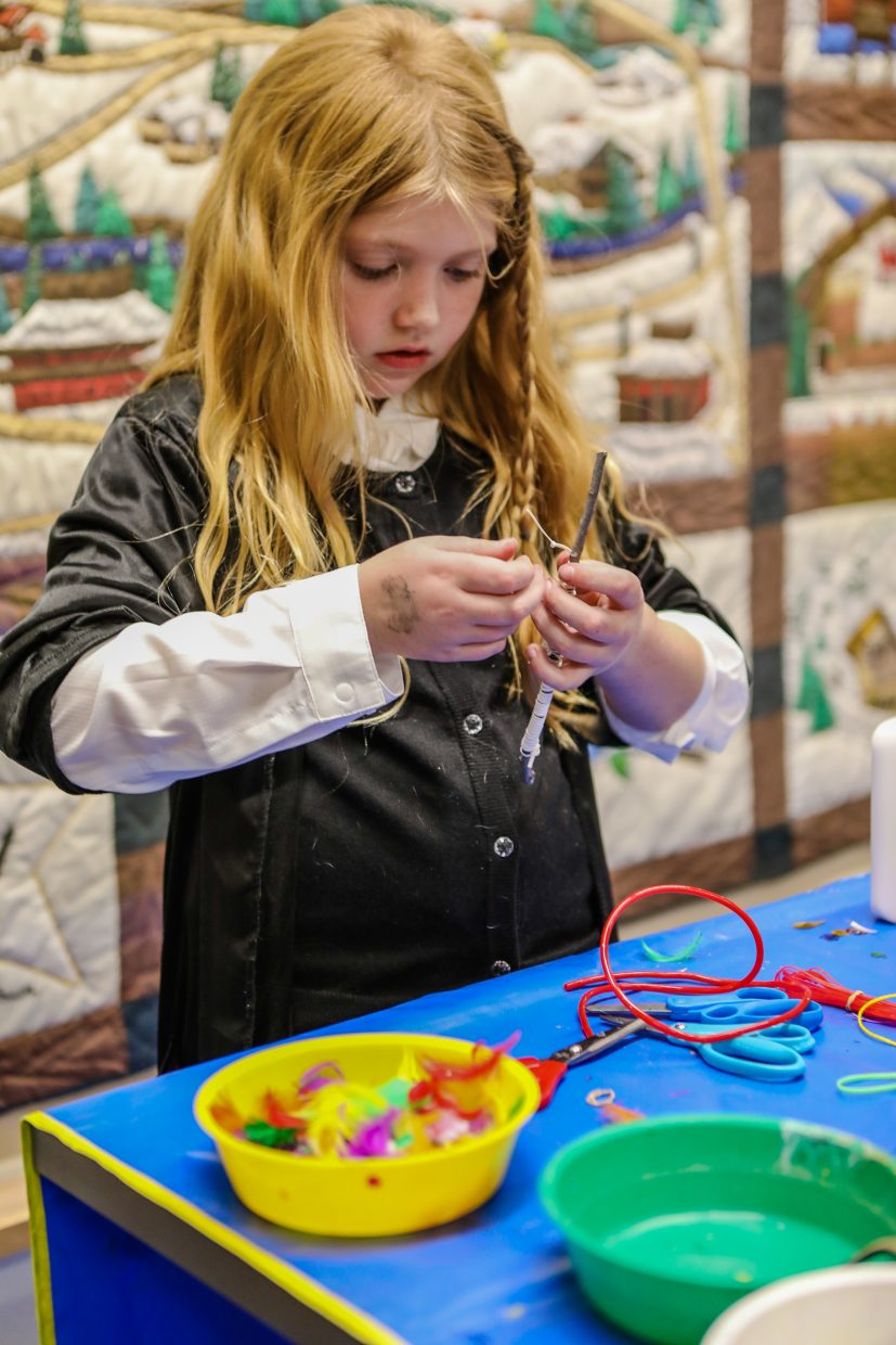 Aris Mosbacher of West Vail makes a wand during the Harry Potter Party through the Vail Public Library Saturday, Nov. 4, in Vail. Wands were made, both real and chocolate, as well as other Harry Potter-themed stations.