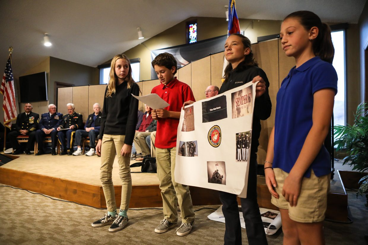 From left, Alexa Hoyos, Tyler Bahan, Elizabeth Keiser and Sofia Rindone explain about the United States Marine Corps during the Veterans Day program Tuesday, Nov. 7, at Stone Creek Charter School in Edwards. Students explained to local veterans about the different branches of military.