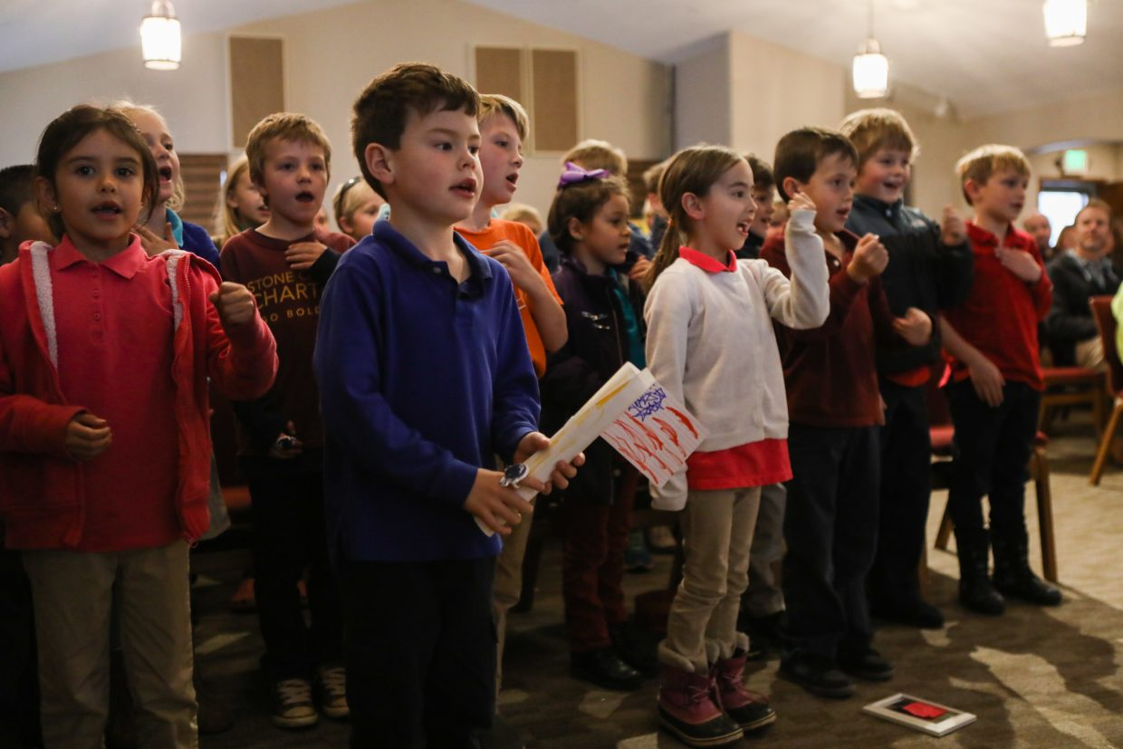 Students sing patriotic songs during the Stone Creek Charter School Veterans Day program Tuesday, Nov. 7, in Edwards. Kids from all grades participated in the program.