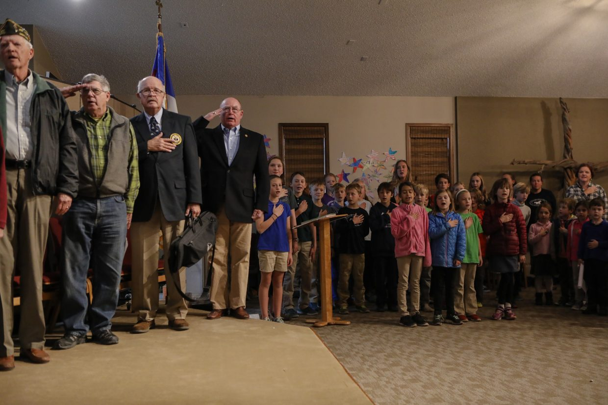 Veterans and students say the Pledge of Allegiance during the Stone Creek Charter School's Veterans Day program Tuesday, Nov. 7, in Edwards. Veterans from the local VFW came into to talk to the kids about their time in the service.