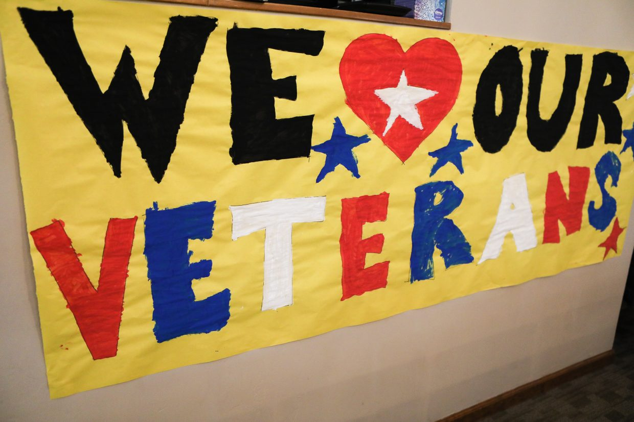 Students from Stone Creek Charter School made signs welcoming the veterans from the local VFW for the Veterans Day program Tuesday, Nov. 7, in Edwards. The hour-long program was interactive between the students and the veterans.