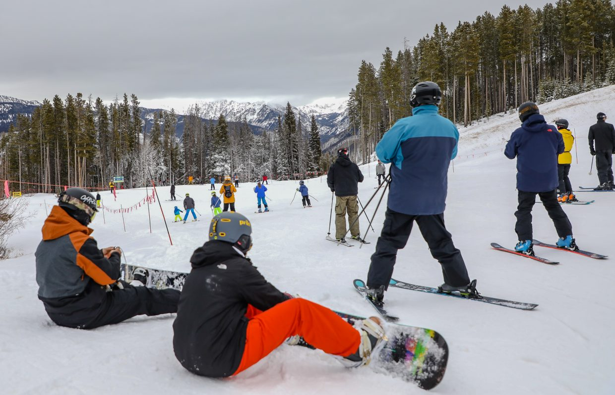 People strap in atop the Born Free Express during Vail's Opening Day Wednesday, Nov. 22, in Vail.