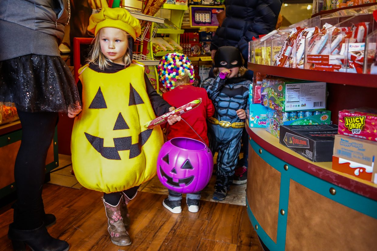 Willow Decent wears her homemade pumpkin costume during the annual Vail Recreation District's Trick or Trot Tuesday, Oct. 31, in Vail Village. The event always takes place rain, shine or snow.