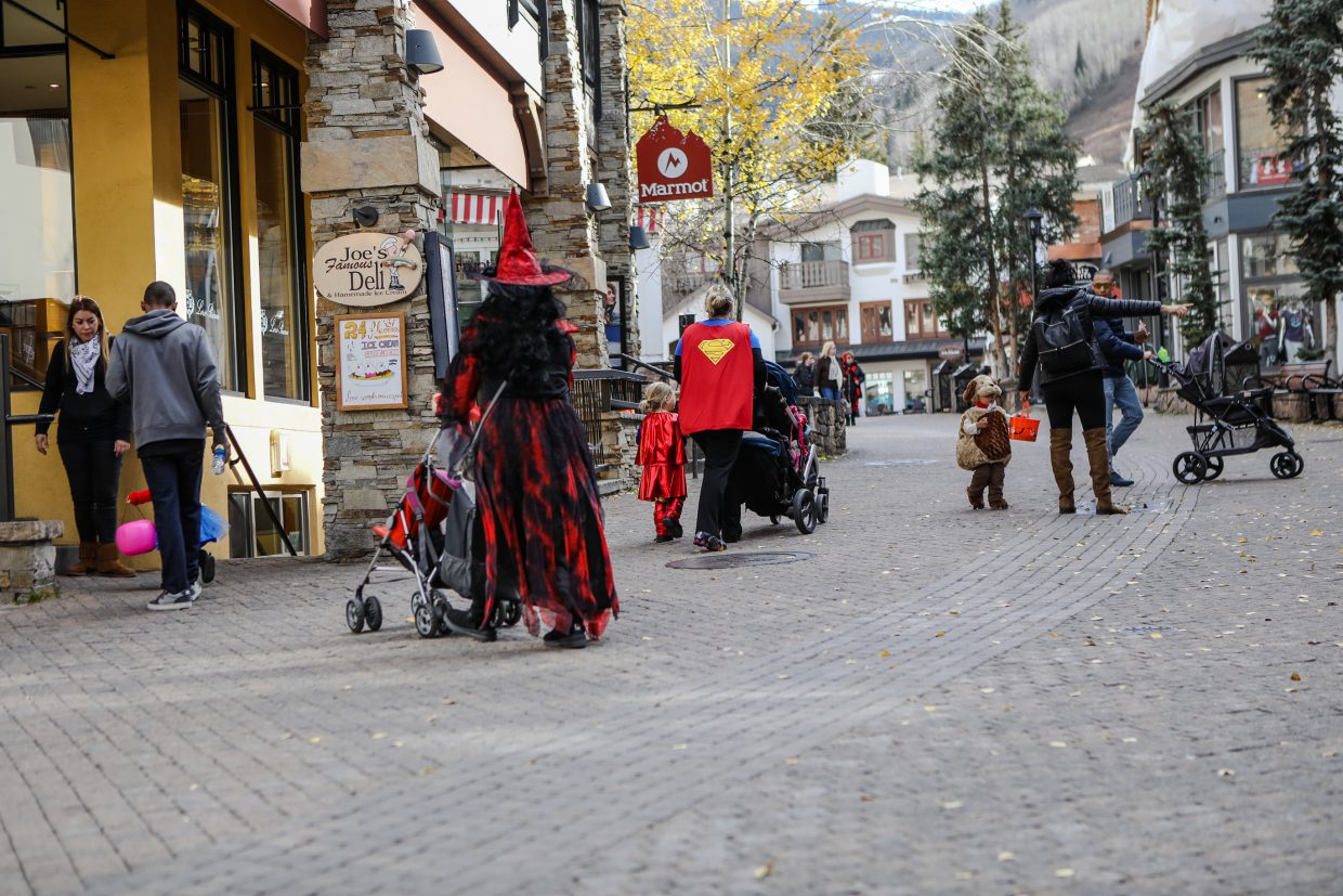 People make their way up Bridge Street for the annual Vail Recreation District's Trick or Treat Trot Tuesday, Oct. 31, in Vail. Spooky tails were told at the Vail Public Library before trick-or-treating.