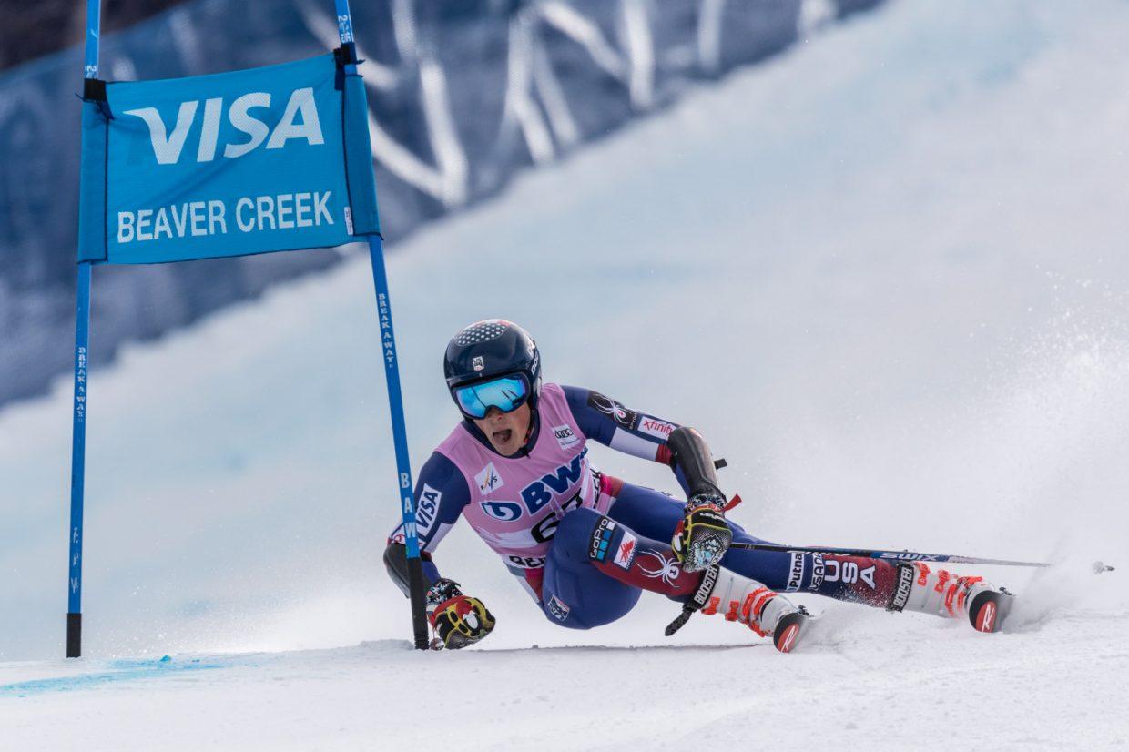 River Radamus, of the United States, passes a gate the Harrier section of the Birds of Prey World Cup Giant Slalom course during his first run Sunday in Beaver Creek.