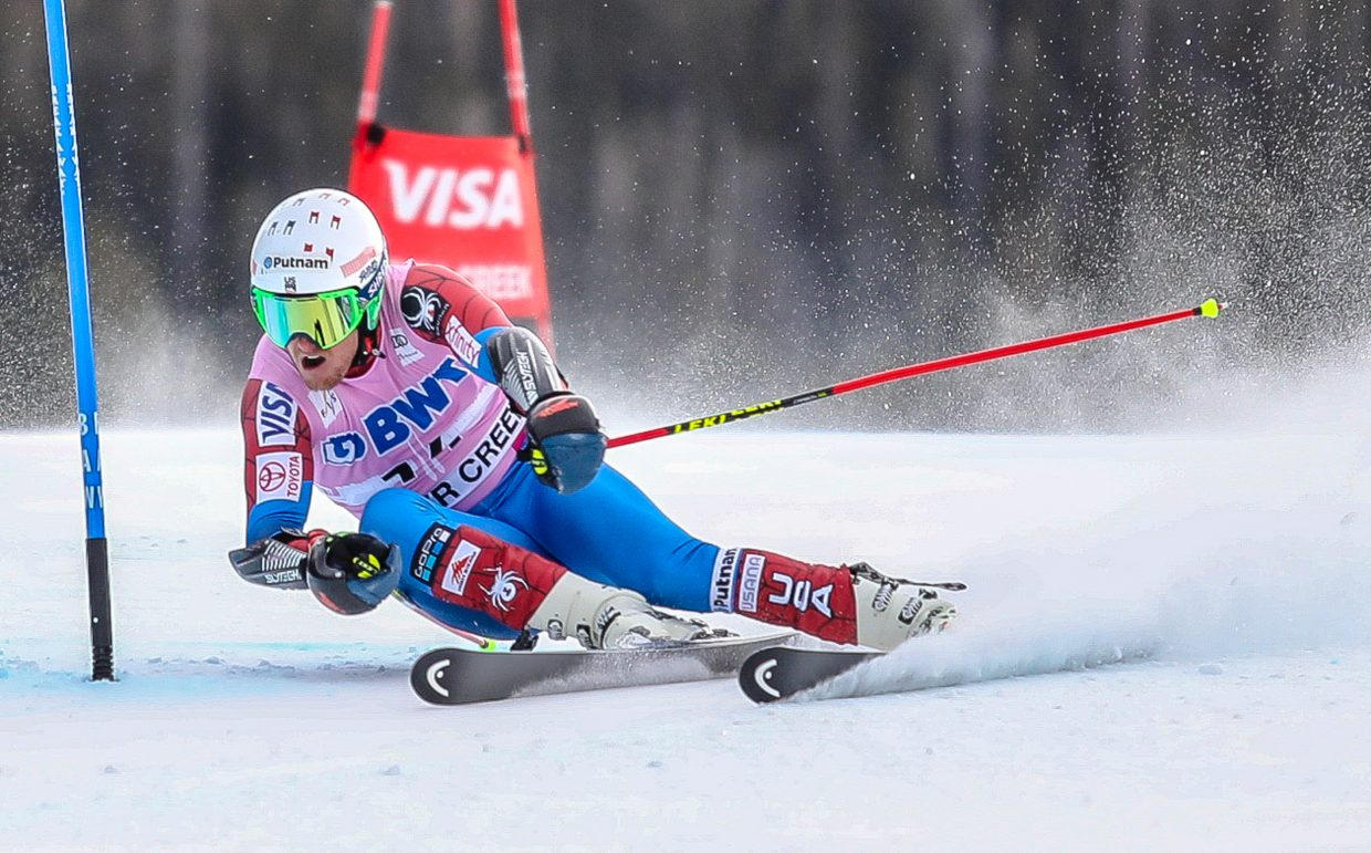 Ted Ligety, of USA, clears a gate for the Giant Slalom during the Birds of Prey World Cup on Sunday, Dec. 3, in Beaver Creek. Ligety is sitting second at the split before run two.