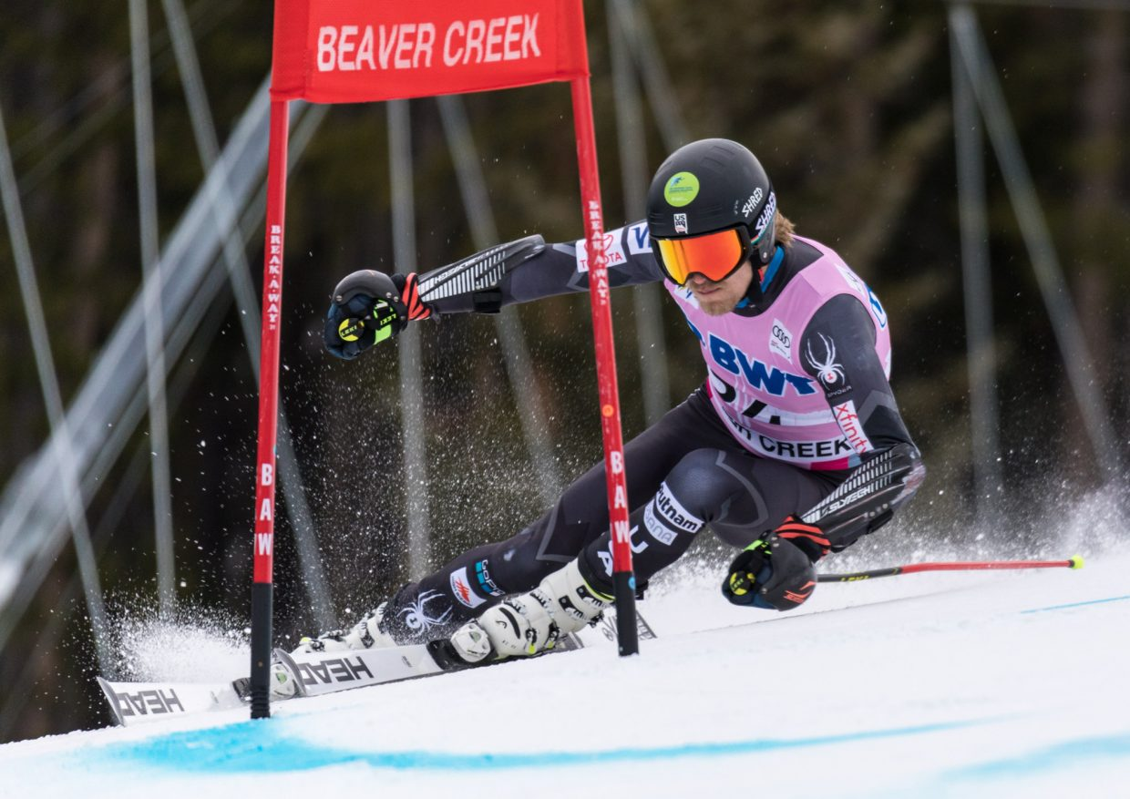 Tommy Ford, of the United States,  looks forward to his next turn while passing the Harrier section of the Birds of Prey World Cup Giant Slalom course during his second run Sunday in Beaver Creek.